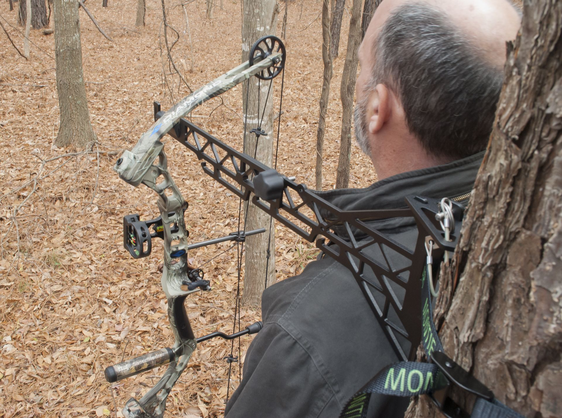 Hunter's Friend holding bow in ready position